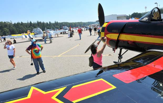Air Fest goers check out a Chinese Nanchang CJ-5.