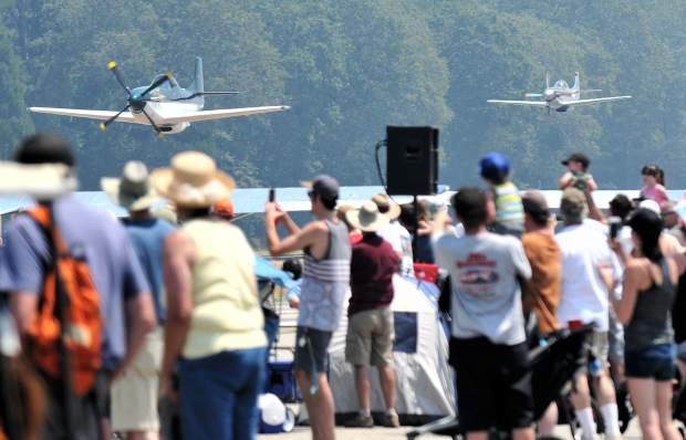 Onlookers await the flyby of a pair of aircraft during the Air Fest.