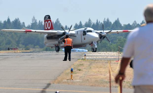 A reserve Cal Fire S-2 airtanker of the Grass Valley Air Attack Base returns to its bay after its service was called off Saturday at the Nevada County Air Park's 2017 Air Fest.