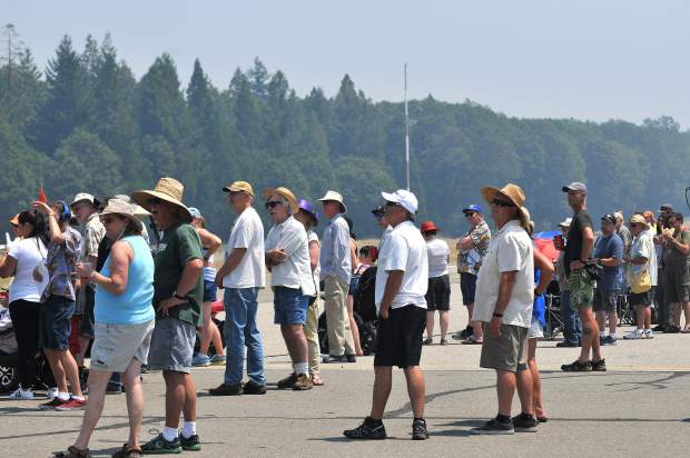 Air Fest crowds watch as planes do flybys above the landing strip of the Nevada County Air Park.