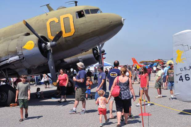 Air Fest goers examine the many different aircraft of all ages, shapes and sizes on display at the 2017 air show held at the Nevada County Air Park.