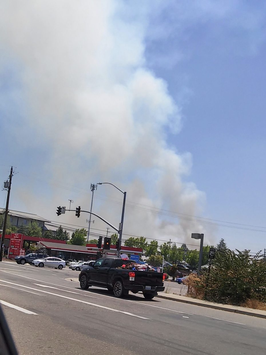 Smoke from the Stagecoach Fire visible from the street near Auburn.