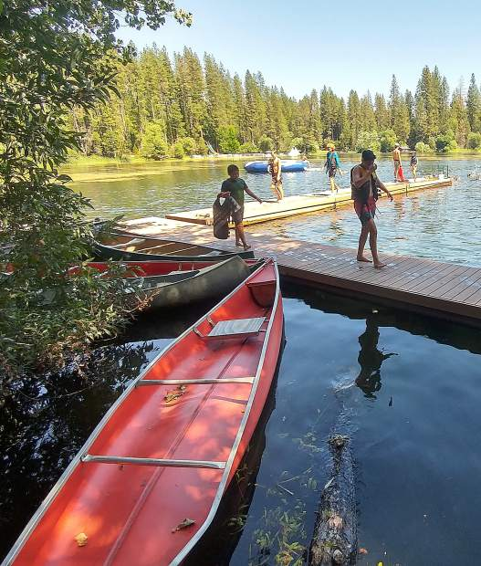 Canoes sit available for Camp Augusta campers to use at the Lake Vera summer camp.