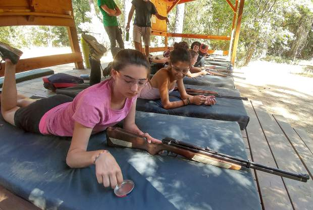 Sofia Ferraro, of Piedmont, readies to shoot an air rifle at one of the more than 150 daily activities offered at Camp Augusta.