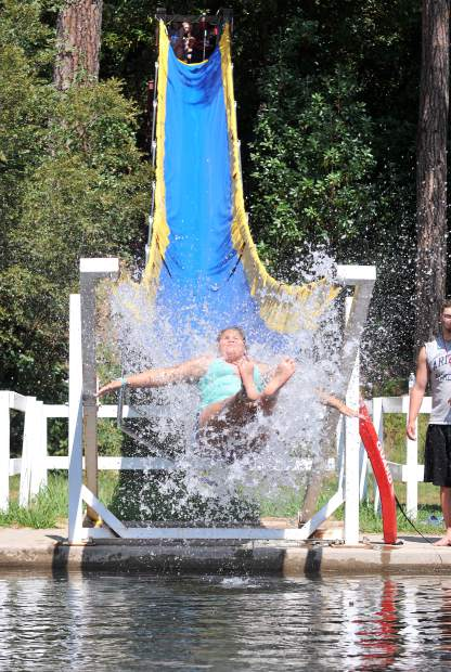 A happy camper on Lake Vera in Nevada City shoots down the popular waterslide, nicknamed 'Wet Willy,' at the Salvation Army's Camp Del Oro.