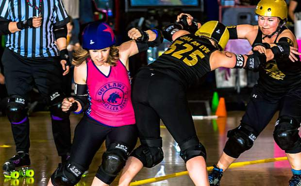 """Outlaws jammer Claire """"Di O'Brawlical"""" Swanson, left, competes during a Roller Derby bout."""