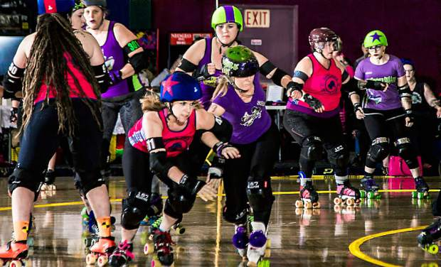 """Outlaws jammer Claire """"Di O'Brawlical"""" Swanson, front left, competes during a Roller Derby bout."""