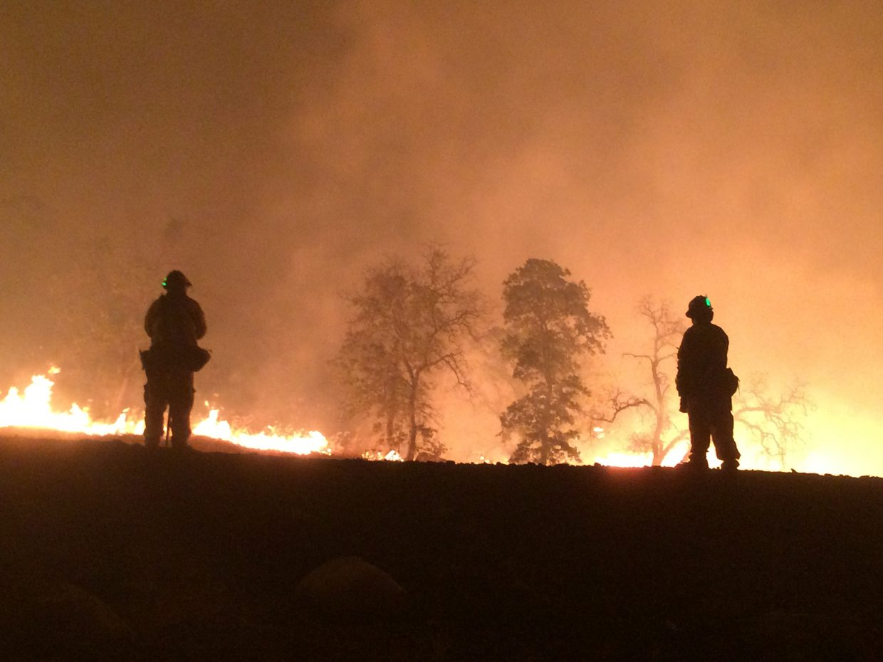 Local firefighters help battle the Detwiler Fire in Mariposa County.