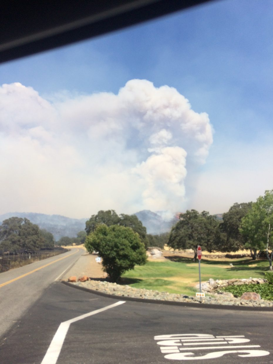 A plume of smoke visible from the streets in Mariposa County.