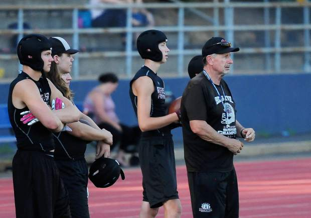 Bear River co-head coach Terry Logue, far right, looks on during a 7-on-7 matchup with Nevada Union earlier this summer.