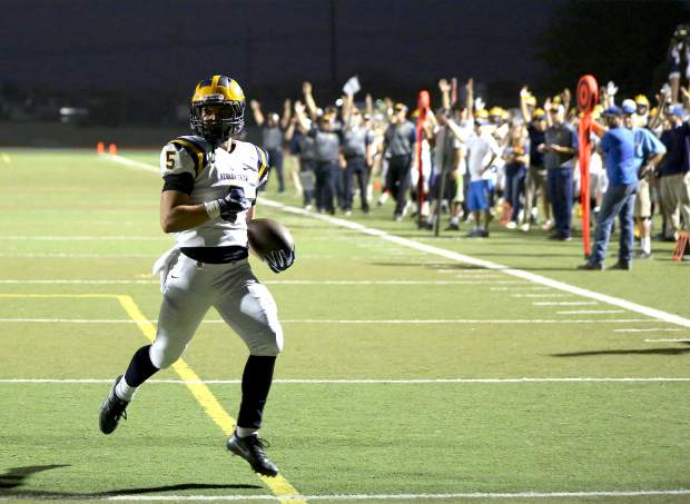Nevada Union's Tyler Nielson trots into the end zone during a game against Lincoln at Lincoln High School Friday night.