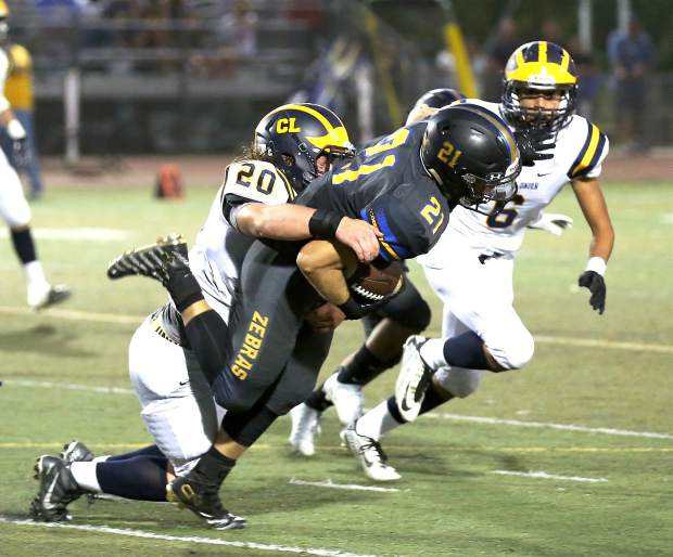 Nevada Union's Justin Houlihan makes a tackle during a game against Lincoln Sept. 9.