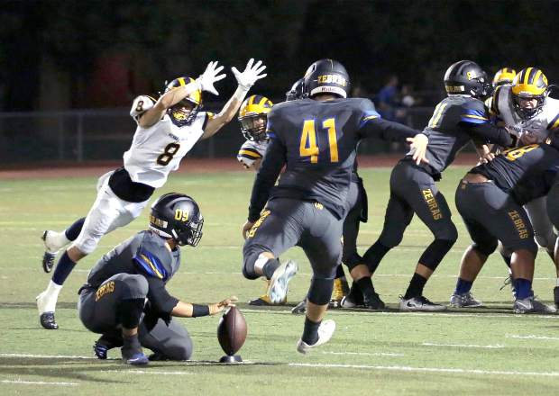 Nevada Union's Andrew Link blocks a field goal attempt during a game against Lincoln at Lincoln High School Friday night.