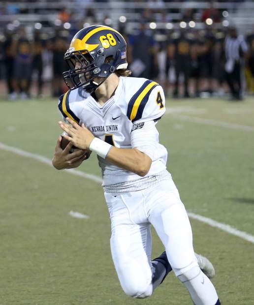 Nevada Union's Dawson Fay runs the ball during a game against Lincoln at Lincoln High School Sept. 9.