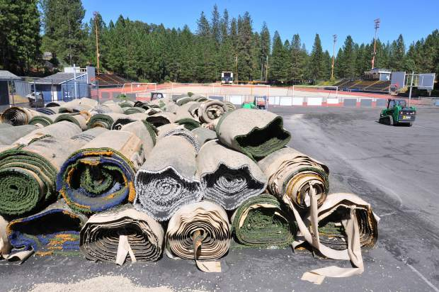 Nevada Union High School's old synthetic field turf is rolled up and stored on the adjacent basketball courts, until administrators can figure out how to get rid of it.