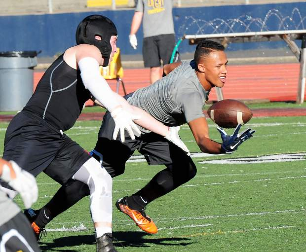 A member of the Nevada Union football team makes a catch during a 7-on-7 matchup against Bear River earlier this summer.