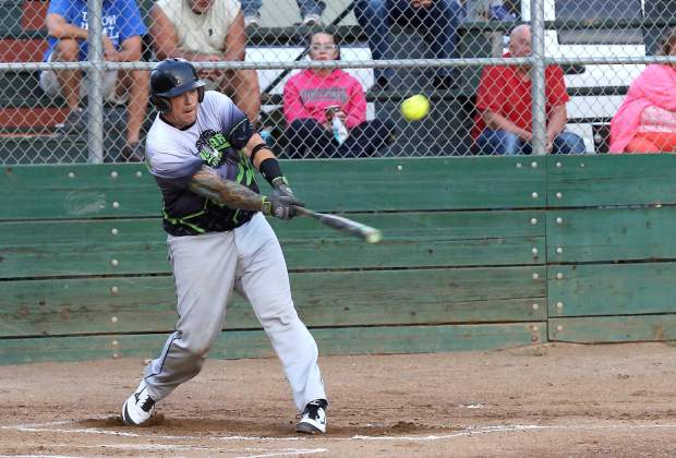Allstar Automotive's Justin Nicholson hits during the Nevada County Fastpitch Softball League's American League Championship at Memorial Park Thursday evening.
