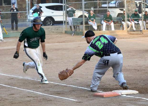 Allstar Automotive's Ryan Jenkins forces the runner out at first during the Nevada County Fastpitch Softball League's American League Championship at Memorial Park Thursday evening.