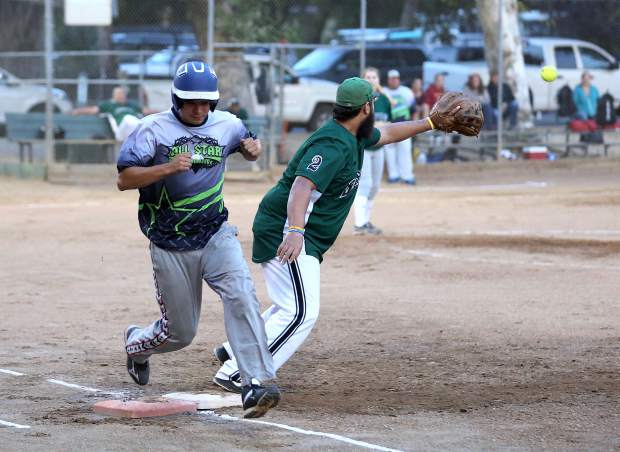 Allstar Automotive's Nick Ullom beats out the throw to first base during the Nevada County Fastpitch Softball League's American League Championship at Memorial Park Thursday evening.