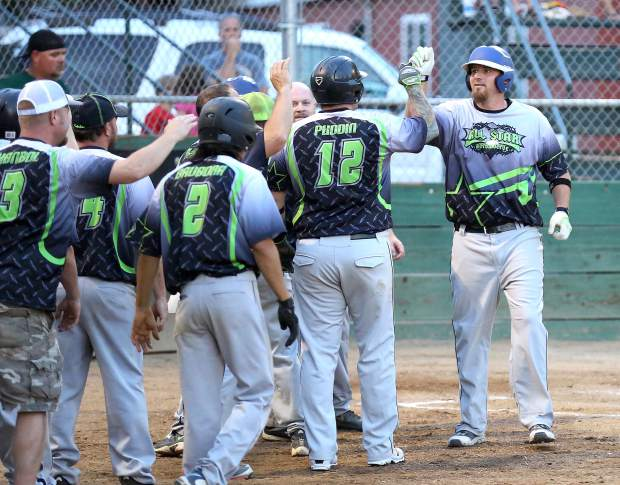Allstar Automotive's Daryl Allen is greeted by his team after hitting a grand slam during the Nevada County Fastpitch Softball League's American League Championship at Memorial Park Thursday evening.