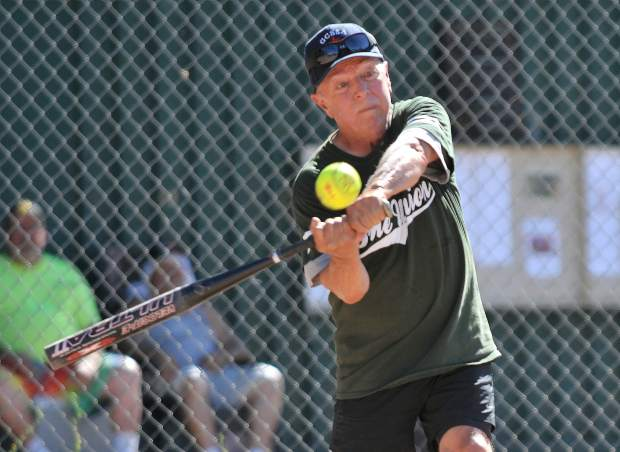 A Gold Country Senior Softball Association player hits a line drive during Thursday's All-Star game.