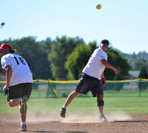 Al Bolen turns a double play during the 60-plus All Star game Thursday at Western Gateway Park in Penn Valley.