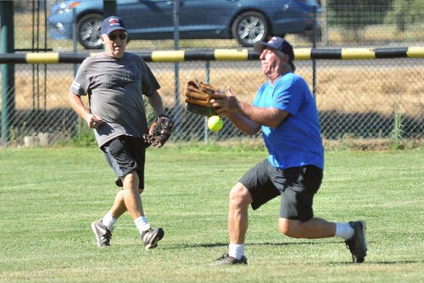 The Gold Country Softball Association's Dominic Albano (right) cant hold onto a flyball while teammate Bob Scaletti (left) backs hime up during the Senior All-Star game Thursday.