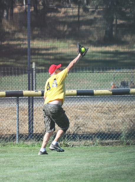 Gold Country Senior Softball Association All-Star Chuck Woerner almost catches this fly ball during Thursday's game.