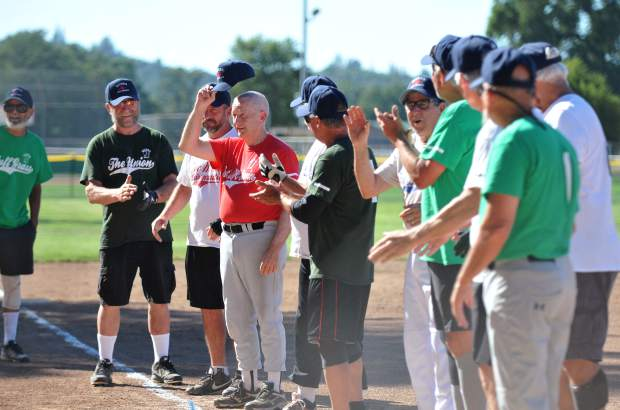 The Gold Country Senior Softball Association's 60-plus All-Stars are recognized before their game Thursday at Western Gateway Park in Penn Valley.
