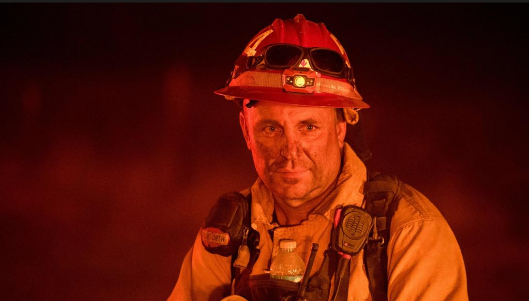 Nevada City fire chief Sam Godspeed stares down flames at the Detwiler Fire July 18.