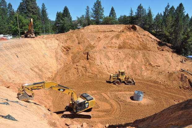 Progress continues on the Little Wolf Creek sinkhole repair project, which includes laying a new culvert in to replace the failed one. A new manhole access can also be seen.