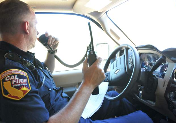 Cal Fire Public Information Officer Roy Skinner radios Division H, where the Grass Valley Cal OES Engine 334 is stationed.