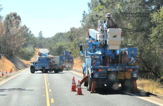 PG&E crews line portions of Forbestown Road in Butte County where the Wall Fire destroyed power poles and downed many power lines. Evacuation orders in those areas won't be lifted until utility services can be restored as well as safe from fire.