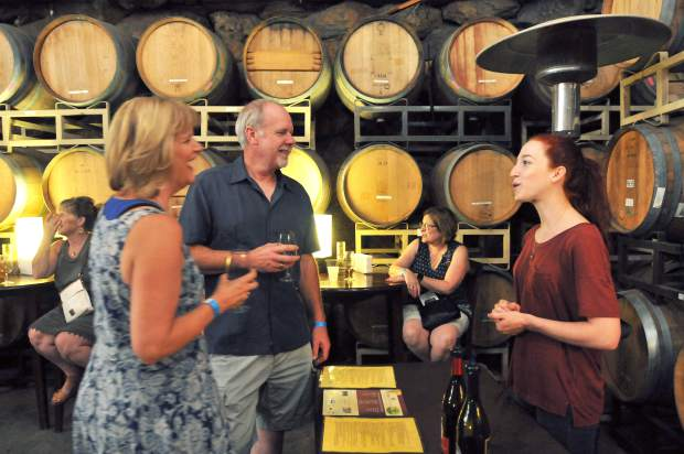 Vina Castellano tasting room hostess Alexis Godtfredsen (right) talks to Penn Valley's Ron and Diane Fontaine about the Abuelito and La Borracha wines she's pouring.