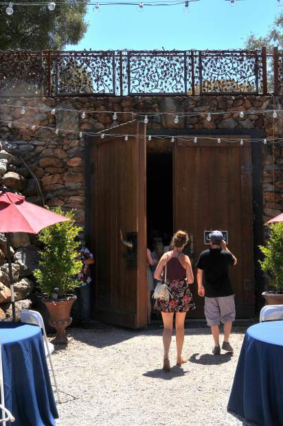 Folks enter the Vina Castellano tasting room, aptly called the cave, during Saturday's wine tour.