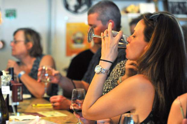 A wine trail enthusiast takes a sip at Fawnridge Winery during Saturday's winery tour.