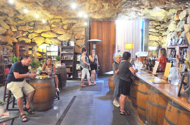 Wine trail travelers enjoy a sip of wine from inside of Vina Castellano's tasting room, called the cave, during Saturday's Sierra Vintner's second wine trail of 2017.