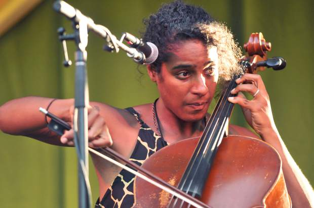Leyla McCalla concentrates as she plays her cello and provides vocals Friday evening on the Spotlite stage of the 2017 California World Fest.