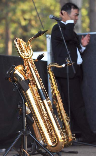 A barritone and tenor saxophone await their performances with the band Supaman Friday evening on the Meadow stage.