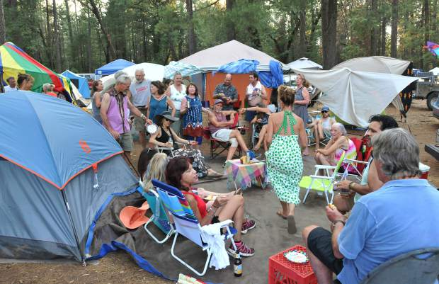 A large group of annual World Fest campers have a merry time under the pines of the Nevada County Fairgrounds Friday evening.