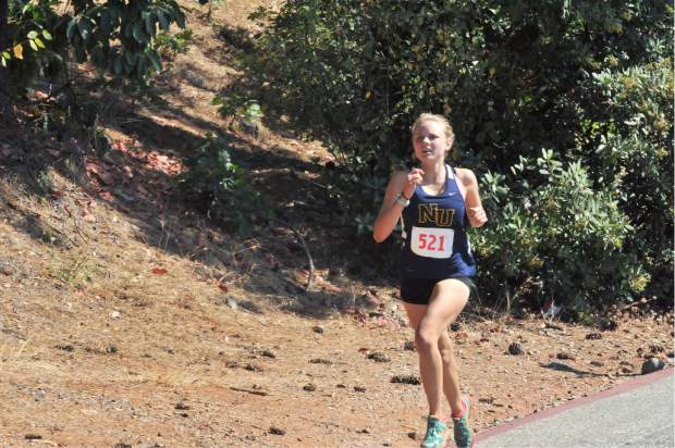 Nevada Union's Anya Cooper-Hynell nears the final stretch at the Nevada Union Cross Country Invitational held at Nevada Union High School, Saturday. Cooper-Hynell placed fifth in the girls varsity race.