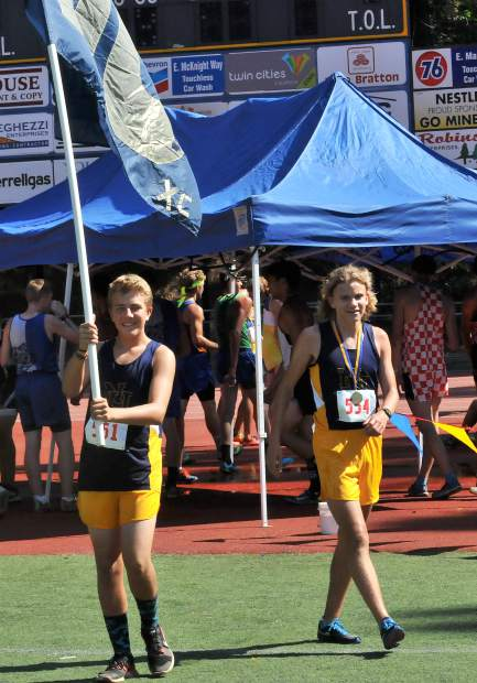 Two Miners show school pride at the Nevada Union Cross Country Invitational held at Nevada Union High School, Saturday.