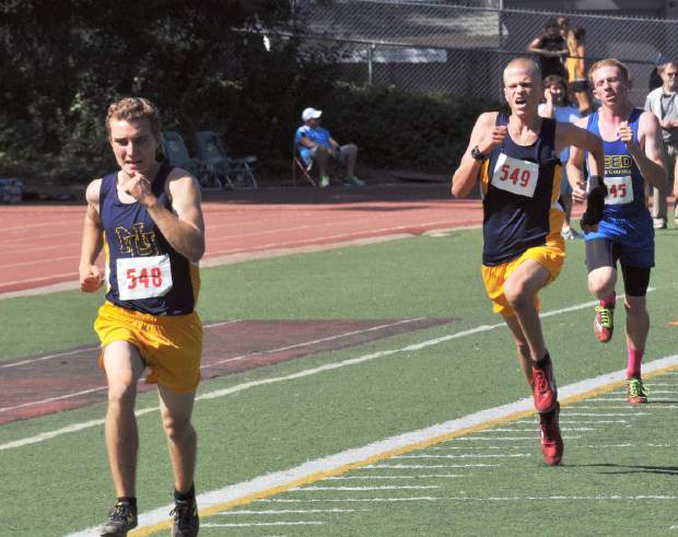Nevada Union's Ben Fogiel, left, and Garrett Gough charge toward the finish line at the Nevada Union Cross Country Invitational held at Nevada Union High School, Saturday. Fogiel placed 10th and Gough was 11th in the boys varsity race.