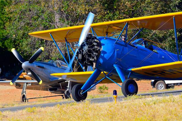 Buzz Elliott of Grass Valley flew his 1933 Waco Biplane during Saturday's 99th Reconnaissance Squadron 100-year celebration. In addition to providing nostalgic fly-bys, Elliott gave numerous squadron enlisted persons their first vintage airplane rides.