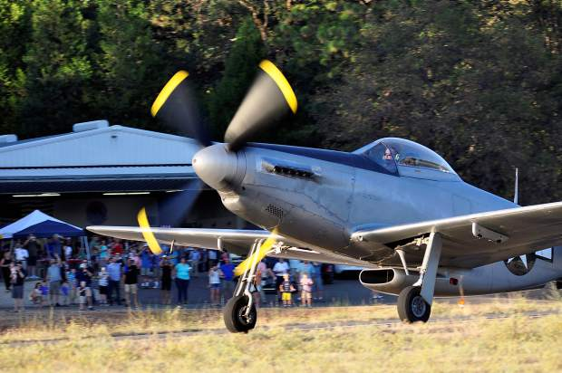 Steve Coutches from Hayward demonstrates his ultra-rare P-51H Mustang before a crowd of nearly 200 at the 99th Reconnaissance Squadron 100th year celebration the Nevada County Airport on Saturday.