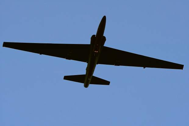 A largely secret and stealthy Lockheed U-2 from the 99th Reconnaissance Squadron at Beale Air Force Base performs a fly-by and maximum performance climb to 15,000 feet over the Nevada County Airport during Saturday's 100th year celebration for the unit.