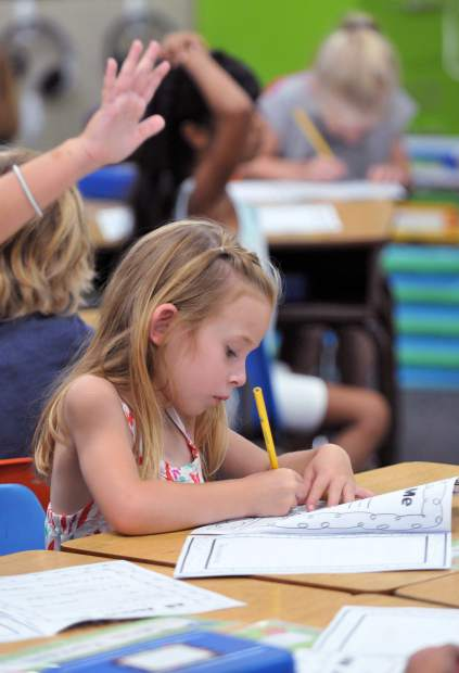 Deer Creek Elementary School student Paige Nunnink concentrates on one of her first assignments of the school year on the first day of school in Nevada City.