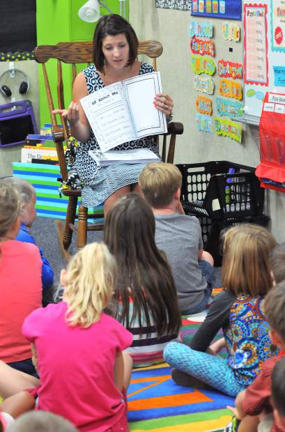 Deer Creek Elementary first grade teacher Mrs. Russo goes over some of her students' first tasks as school children during the first day of school Wednesday morning in Nevada City.