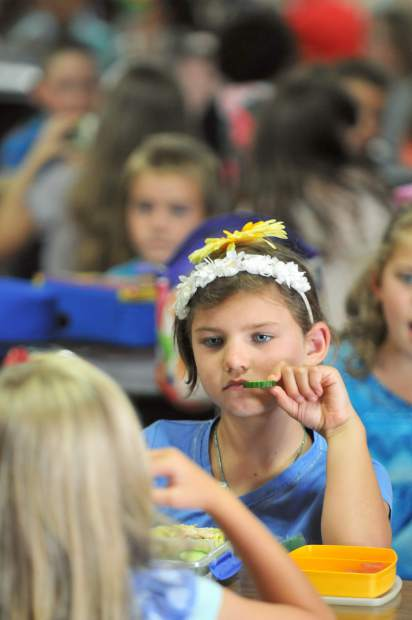 A Deer Creek Elementary School student enjoys her lunch during the first day of school Wednesday in Nevada City.
