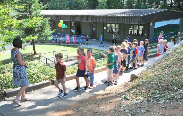 First graders in Mrs. Russo's Deer Creek Elementary School class line up single file while on their way to class Wednesday morning at the Nevada City school.